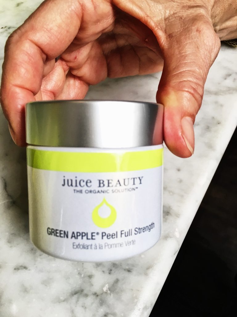 Debby Allbright of Fashionomics holding Juice beauty Green Apple Peel to get those age spots on over 40 skin.