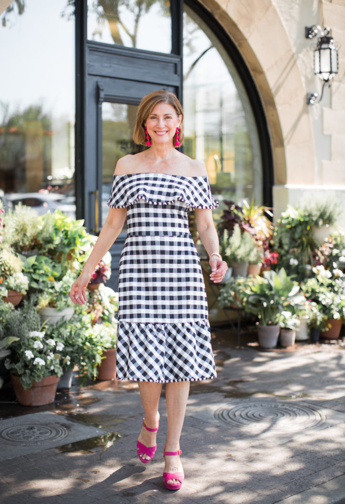 Summer dresses for over 50 blogger and wardrobe consultant in black and white check.