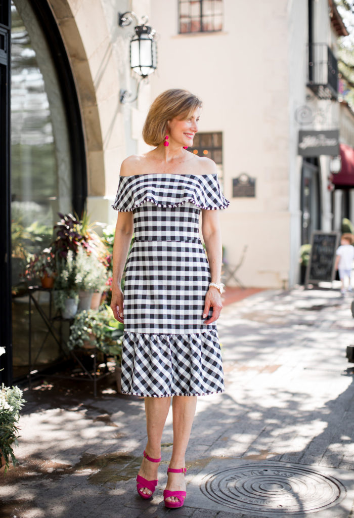 Fashionomics features black and white check dress from Ann Taylor.