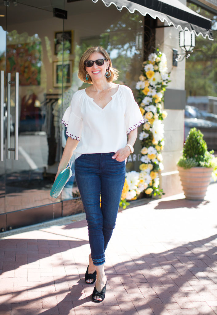 Dallas Blogger wearing white embroidered blouse from Ann Taylor.