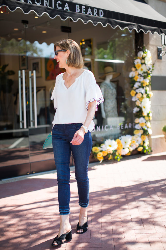 White embroidered blouse on over 50 blogger with Michael Kors watch.