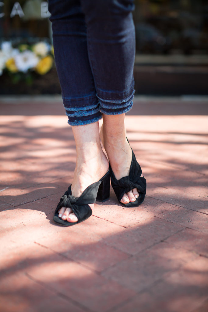 Frayed hems and suede slides are casual fashion for summer style.