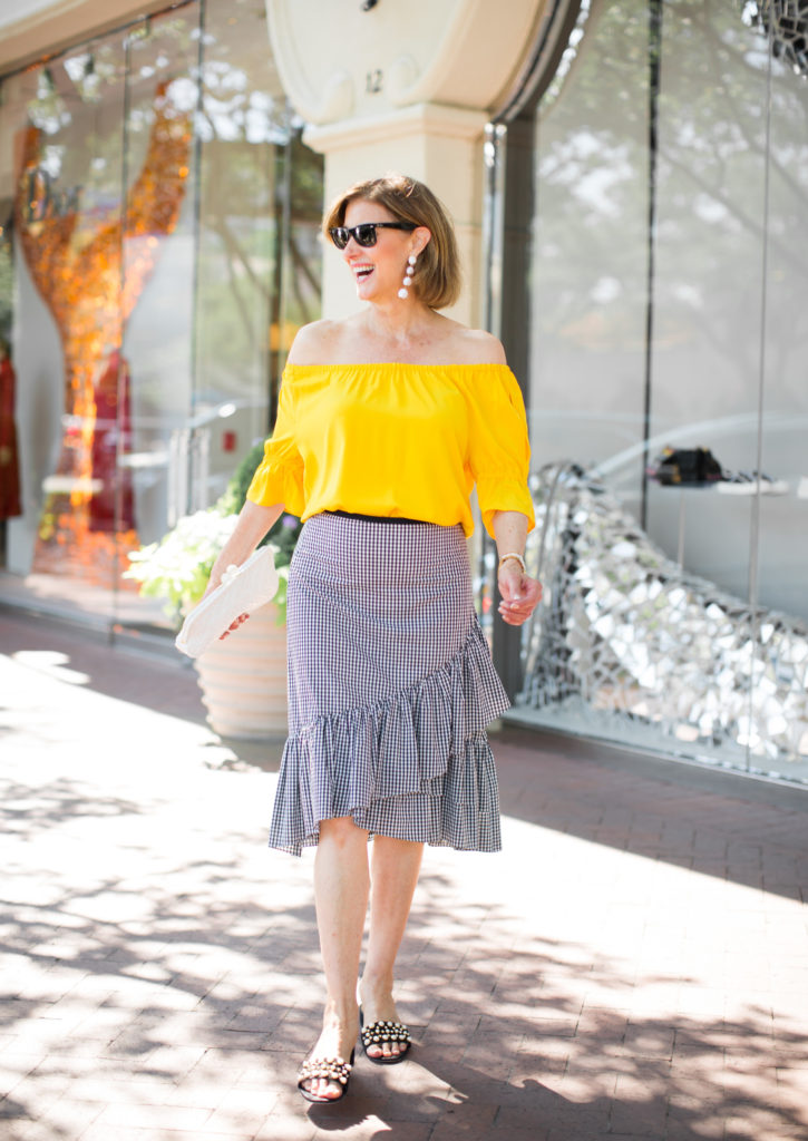 Debby Allbright Fashion Blogger wearing yellow off the shoulder top with gingham skirt