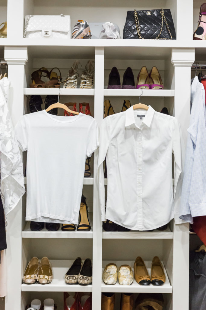 Fashionomics recommends a white shirt and basic white tee in your closet essentials list.