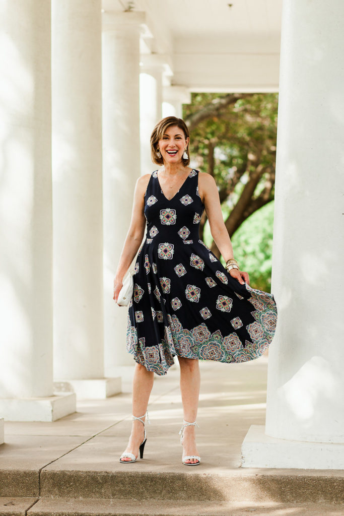 Handkerchief hem and navy geo pattern make a perfect on trend summer dress for special occasions.