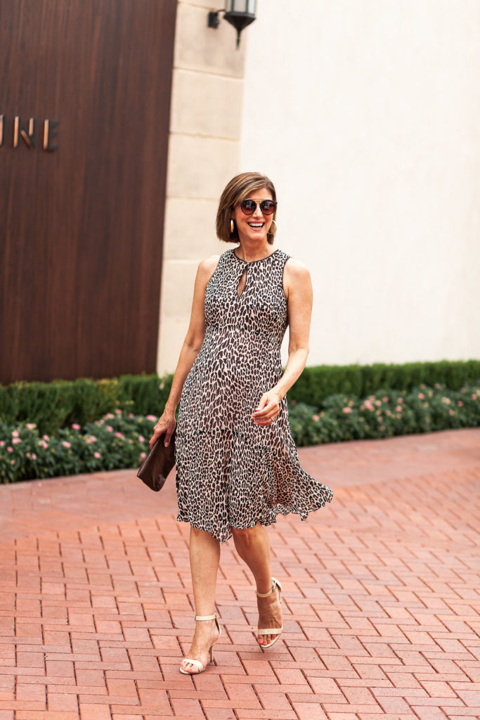 Flirty silk dress with nude sandal and brown clutch goes summer to fall.