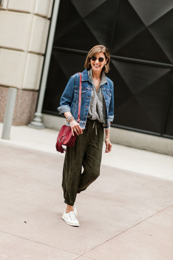 Fall athleisure looks - joggers paired with denim jacket.