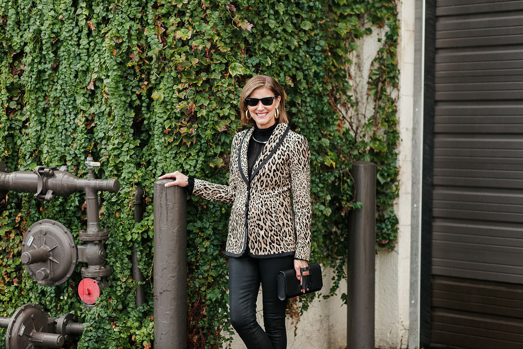 Fashionomics over 50 blogger rocks this leopard print blazer