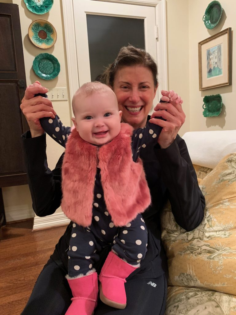 Sloan is wearing Hartley fur vest and pink Ugg boots for Christmas-gift-guide-for-children