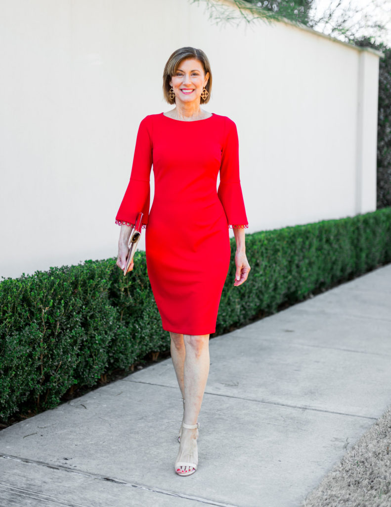 Fashionomics over 50 blogger in red Calvin Klein Dress
