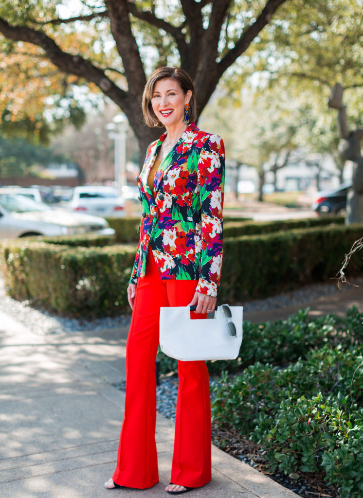 Red pants from Veronica Beard with bold floral blazer on over 50 Dallas blogger