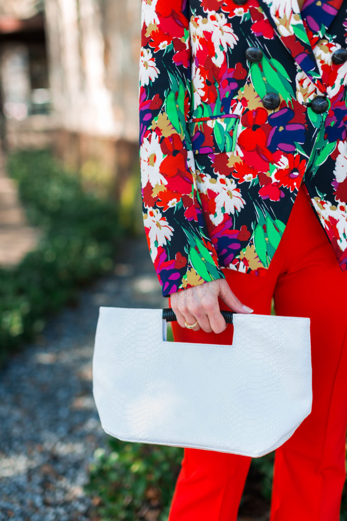 Dressing is in the details like white snakeskin clutch from Oliveve