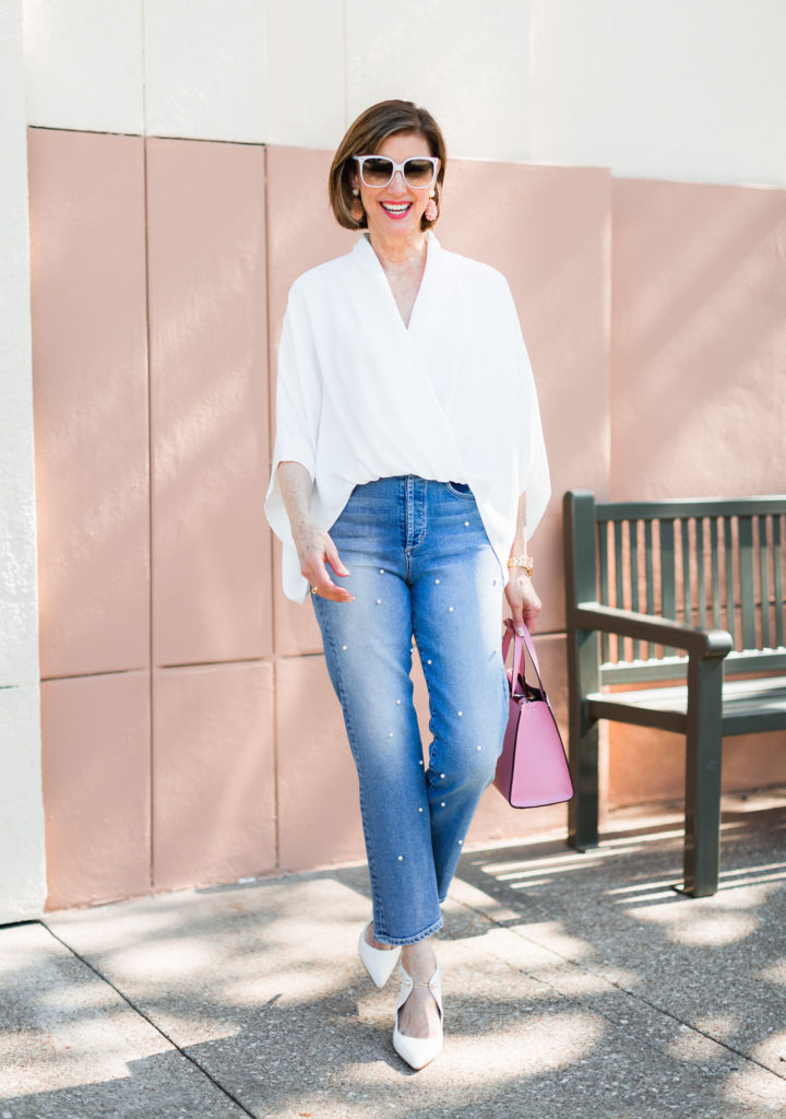 Fashionomics Debby Allbright wearing high waisted jeans with pearls