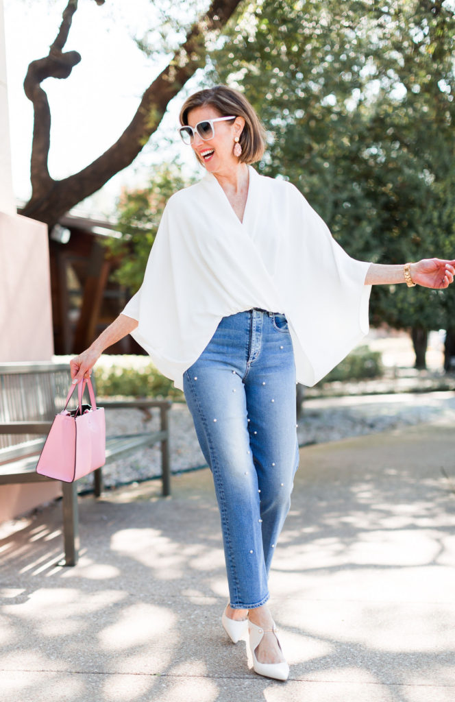Dallas blogger wearing pearl embellished jeans with white heels and top