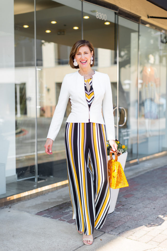 Mignonne Gavigan Statement earrings a mustard straw bag Silvia Tcherrassi
