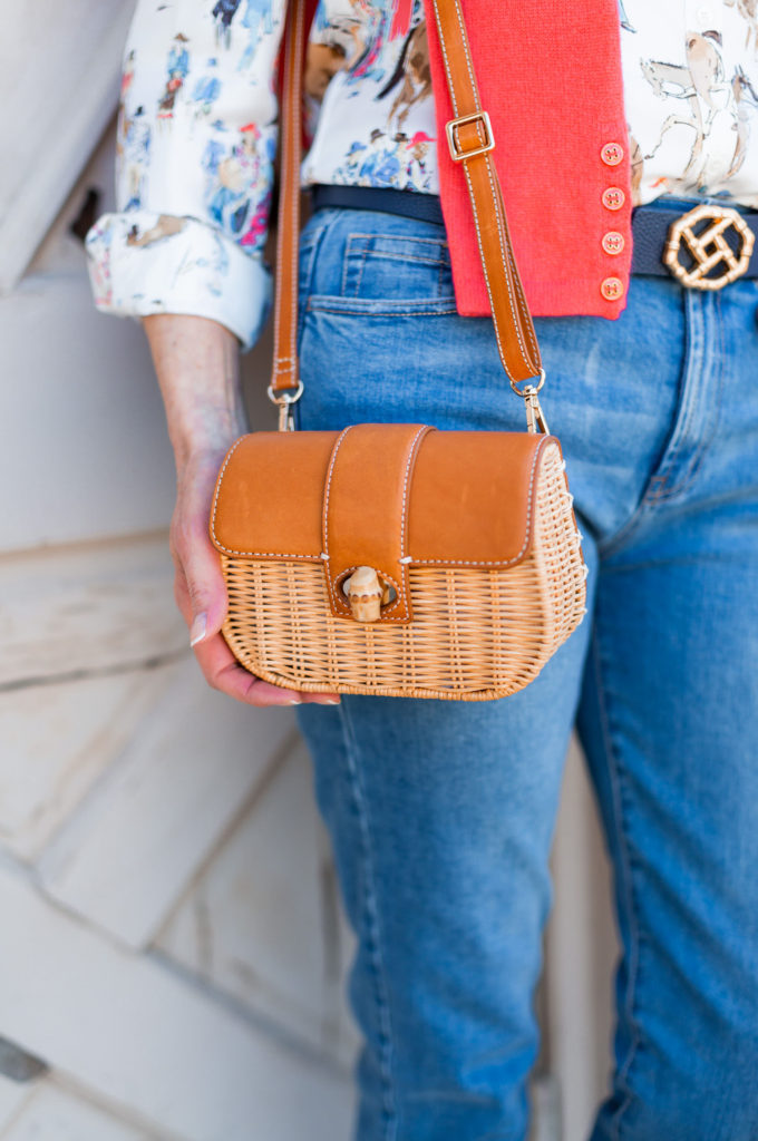 Fanny pack or cross body straw bag on over 50 blogger